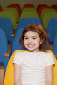 Girl sitting in the cinema hall — Foto Stock