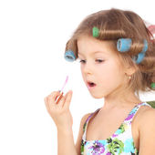 Little girl making makeup — Stock Photo