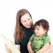 Mother teaching her little child — Stock Photo #49592847