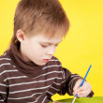 Cute little boy painting — Stock Photo #49593499