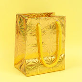 Gold gift parcel — Stock Photo