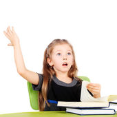 Surprised little girl with the books — Foto de Stock