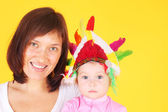 Mother playing American Indian with  baby — Stock Photo