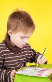 Cute little boy painting — Stock Photo