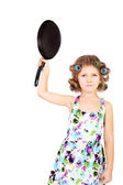 Girl in curlers and with the pan — Stock Photo