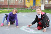 Girls drawing with color chalks — Stock Photo