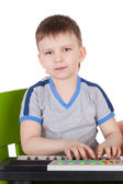 Boy playing with the toy composer — Stock Photo