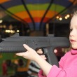 Girl playing with the big pistol — Stock Photo #51205397