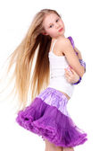 Dancing blonde teenage girl — Stock Photo