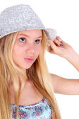 Girl posing in dress with  hat — Stock Photo