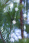 Firtree decorated with snowflakes — Stock Photo