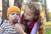 Children eating ice-cream in the park — Stock Photo