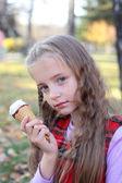 Little girl eating the ice-cream — Stock Photo