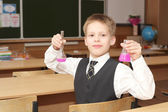 Boy with the pink chemical agent tubes — Stock Photo