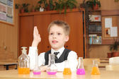 Boy with the pink chemical agent tubes — Foto de Stock