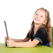 Little girl playing with computer — Stock Photo