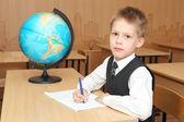 Little boy in a classroom — Stockfoto