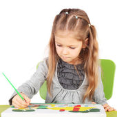 Little talented girl painting — Stock Photo