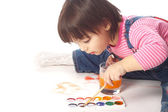 Child painting with watercolors — Stock Photo