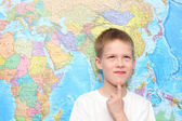 Little boy near the wall map — Stock Photo