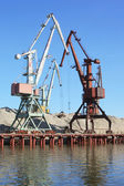 Floating cranes over the river — Stock Photo