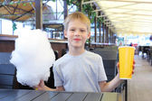 Little boy with cotton candy — Stock Photo