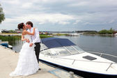 Bride and bridegroom kissing — Stock Photo