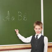 Little boy near the blackboard — Stockfoto