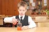 Boy with the  chemical agent tubes — Zdjęcie stockowe