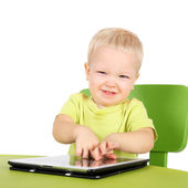Baby with the tablet PC — Photo