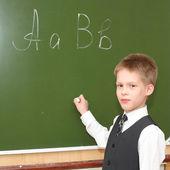 Little boy near the blackboard — Stock Photo