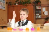 Boy with the chemical agent tubes — Stock Photo