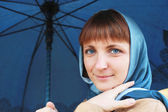 Woman with the blue umbrella — Stock Photo