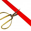 Cutting a red ribbon with scissors. — Stock Photo