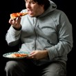 Overweight man eating a pizza. — Stock Photo