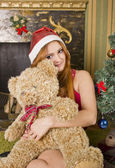 Santa girl with bear — Stok fotoğraf