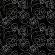Seamless pattern with skulls — Stock Vector