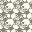 Stock Vector: Seamless pattern with skulls