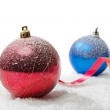 Christmas balls on snow — Stock Photo