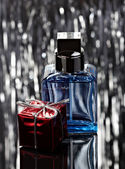 Abstract blue bottle of perfume — Stock Photo