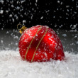 An image of christmas ornaments in snow - Stock Photo