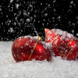 An image of christmas ornaments in snow — Stock Photo