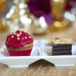 Fancy gourmet cupcake and slice of cake at a wedding — ストック写真