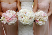 Brides and bridesmaids wedding bouquets — Stock Photo
