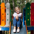 Child in Ukrainian style shirt on a swing — Stock Photo #14030243