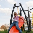 Girl riding rides on a child playground — Stock Photo