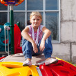 Girl riding rides on a child playground — Stok fotoğraf