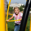 Girl riding rides on a child playground — Stock Photo #14032493