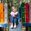 Child in Ukrainian style shirt on a swing — Stock Photo #14033059