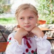 Young girl posing in an outdoor cafe — Stock Photo #14034887